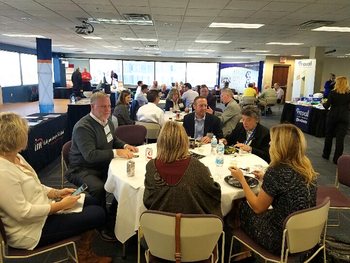 Oames Members And Exhibitors Network Over Lunch